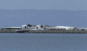 The wreckage of Asiana Flight 214 is seen after it crashed at San Francisco International Airport in San Francisco, Saturday, July 6, 2013.