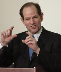 This Nov. 12, 2009 photo shows former New York Gov. Eliot Spitzer addressing an audience during a Harvard University ethics forum.