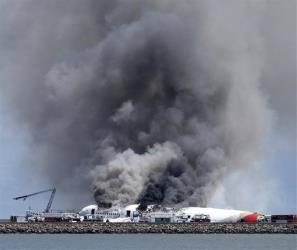 Fire crews work the crash site of Asiana Flight 214 at San Francisco International Airport in San Francisco, Saturday, July 6, 2013.