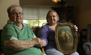Shelia Reese, right, sits with her mother Chris Tench holding a portrait of Tench and her father Kenneth F. Reese, a soldier who is still Missing In Action from the Korean War.
