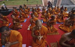 Buddhist monks from Thailand offer prayers at the Mahabodhi, or the Great Awakening, Temple, in Bodh Gaya, India, Monday, July 8, 2013.