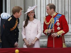 Britain's Prince Harry, left, Kate, Duchess of Cambridge, center, and Prince William, on the balcony of Buckingham Palace, during the Trooping The Colour parade, in London, Saturday, June 15, 2013.