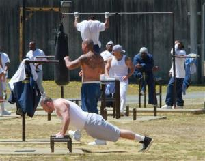 Inmates exercise in the main yard of the general population yard at the Pelican Bay State Prison near Crescent City, Calif.