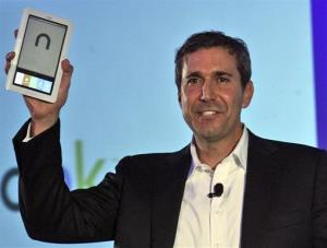 FILE - In this Oct. 20, 2009 file photo, William Lynch, then president of Barnes & Noble.com, unveils the nook electronic-book reader during a news conference in New York. Barnes & Noble Inc. on Monday, July 8, 2013 said that Lynch has stepped down as CEO, effective immediately, just...