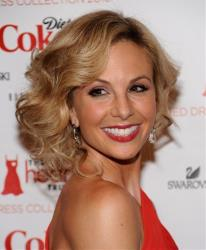 Elisabeth Hasselbeck arrives at The Heart Truth's Red Dress Collection fashion show in New York.