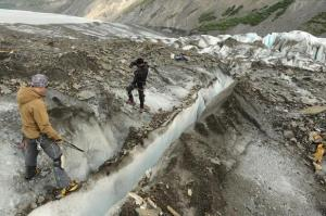 Members of a recovery team from the Joint POW/MIA Accounting Command prepare to search a crevasse.
