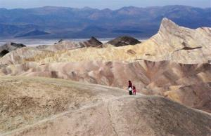 Tourists walk along a ridge at Death Valley National Park, which recorded a temperature of 134F 100 years ago today.