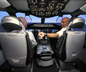 Two pilots sit in a Boeing 787 simulator in this file photo.