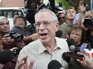 Edward Burkhardt speaks to the media as he tours Lac-Megantic, Quebec, on Wednesday.