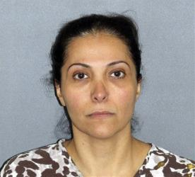 This image provided by the Irvine Police Department shows Meshael Alayban, who was arrested July 9, 2013 in Irvine, Calif., for allegedly holding a domestic servant against her will.