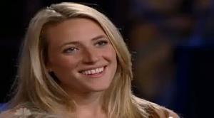 Tara Costa is shown in a YouTube clip.