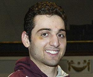 In this Feb. 17, 2010, file photo, Tamerlan Tsarnaev smiles after accepting the trophy for winning the 2010 New England Golden Gloves Championship in Lowell, Mass.
