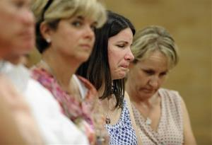Krista Rekos, center, mother of Sandy Hook School shooting victim Jessica Rekos, reacts during a public forum on the distribution of Newtown donations.