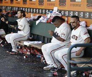 Players sit in the Giants dugout during this file photo.