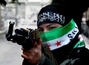 A female Free Syrian Army fighter aiming her weapon, in Aleppo, Syria.