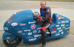 This 2011 photo provided by the Loring Timing Association shows racer Bill Warner.