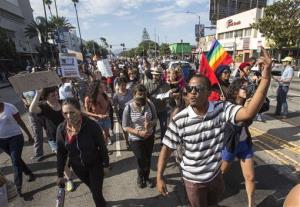 Thousands of demonstrators protest in Los Angeles the day after George Zimmerman was found not guilty in the shooting death of Trayvon Martin.