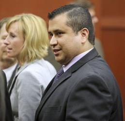 George Zimmerman leaves court with his family after the not guilty verdict was read in Seminole Circuit Court in Sanford, Fla. on Saturday, July 13, 2013.