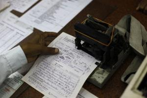 An Indian telegraph employee processes a telegram on the last day of the 163-year-old service at the central telegraph office in Mumbai, India, Sunday, July 14, 2013.