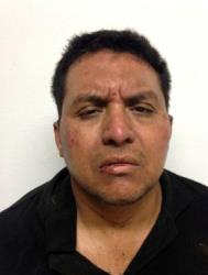 This mug shot released by Mexico's Interior Ministry shows Zetas drug cartel leader Miguel Angel Trevino Morales.
