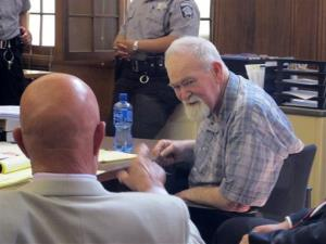John Henry Spooner, 76, right, confers with his defense attorney Monday, July 15, 2013.