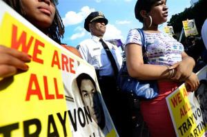 Baltimore Police Commissioner Anthony Batts, center, stands near protesters during a demonstration after the acquittal of George Zimmerman Monday, July 15, 2013, in Baltimore.