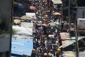 People crowd a street market in Lagos, Nigeria.