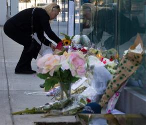 Publicist Lesley Diana, who had worked with Canadian actor Cory Monteith, places flowers at a memorial for him in Vancouver.
