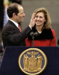 New York Gov. Eliot Spitzer takes his oath of office in this Jan. 1, 2007 file photo, at the New York State Capitol in Albany, N.Y., as his wife, Silda Wall Spitzer, watches.  The New York Times is reporting Monday, March 10, 2008 that Gov. Eliot Spitzer has told...