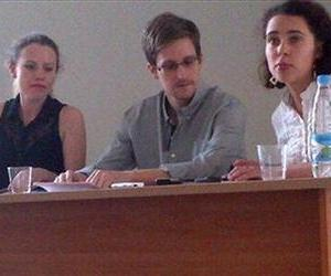 In this Friday, July 12, 2013 file photo originally made available by Human Rights Watch, NSA leaker Edward Snowden attends a meeting with Russian activists and officials at Sheremetyevo airport.