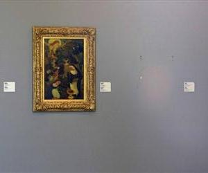 This Tuesday Oct. 16, 2012 file photo shows the empty space where Henri Matisse' painting La Liseuse en Blanc et Jaune was hanging, right.
