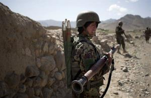 This May 17, 2012 file photo shows Afghan National Army soldiers on patrol in the village of Noor Khiel, Logar province, east Afghanistan.