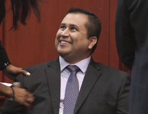In this image from video, George Zimmerman smiles after a not guilty verdict was handed down in his trial at the Seminole County Courthouse, Sunday, July 14, 2013, in Sanford, Fla.