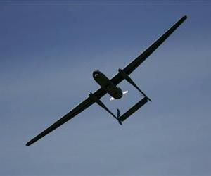 In this March 7, 2007 file photo The Israeli army's Heron unmanned drone aircraft for surveillance missions flies during a display at the Palmahim Air Force Base, Israel.