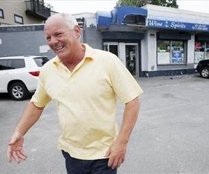 Stephen Rakes smiles after greeting an acquaintance outside the liquor store he once owned in the South Boston neighborhood of Boston, June 6, 2013.
