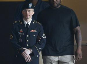 Army Pfc. Bradley Manning is escorted to a waiting security vehicle outside of a courthouse in Fort Meade, Md., on July 15.