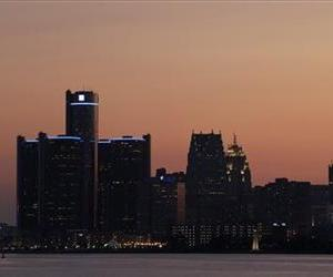 The sun sets on Detroit, Thursday, July 18, 2013.