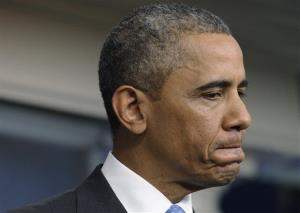 President Obama pauses as he speaks about Trayvon Martin.