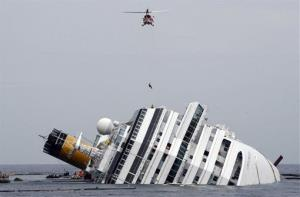 In this Tuesday, Jan. 31, 2012 file photo, an Italian firefighter is lowered from a helicopter onto the grounded Costa Concordia cruise ship off the Tuscan island of Giglio, Italy.