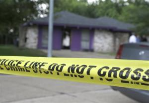 Authorities investigate a home Friday in Houston where police say four homeless men were found in deplorable conditions.