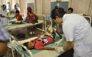 Indian children who fell ill after eating lunch undergo treatment at a hospital in Patna, India, Saturday.