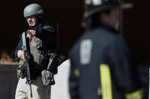 A heavily armed United States Marshal stands guard outside the Moakley Federal Court House in Boston after the building was evacuated, Wednesday, April 17, 2013.