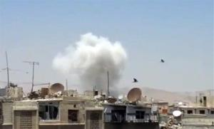 In this image taken from video obtained from the Shaam News Network, which has been authenticated based on its contents and other AP reporting, columns of smoke billow above houses as a result of heavy bombing in Damascus, Syria, Monday July 22, 2013. Syrian rebels seized a strategic village on...