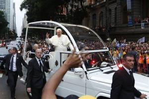 A crowd of faithful cheer as Pope Francis rides in his popemobile in Rio de Janeiro, Brazil, Monday July 22, 2013.