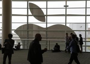 In this June 10, 2013, file photo, people wait for the doors to open for the start of the keynote address at the Apple Worldwide Developers Conference in San Francisco.