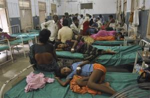 Indian children who fell sick after eating a free school lunch lie at a hospital in Patna, India, Wednesday, July 17, 2013.