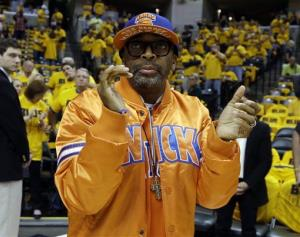 Spike Lee claps before the start of Game 6 of an Eastern Conference semifinal NBA basketball playoff series between the Indiana Pacers and the New York Knicks Saturday, May 18, 2013, in Indianapolis.