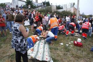 Emergency personnel respond to the derailment in Spain.