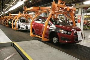 In this April 25, 2012 file photo, Chevrolet Sonics move down the line at the General Motors Orion Assembly plant in Orion Township, Mich.