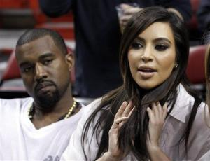 Kim Kardashian, right, and Kanye West, left, are shown before an NBA basketball game between the Miami Heat and the New York Knicks in this Dec, 6, 2012 file photo taken in Miami.